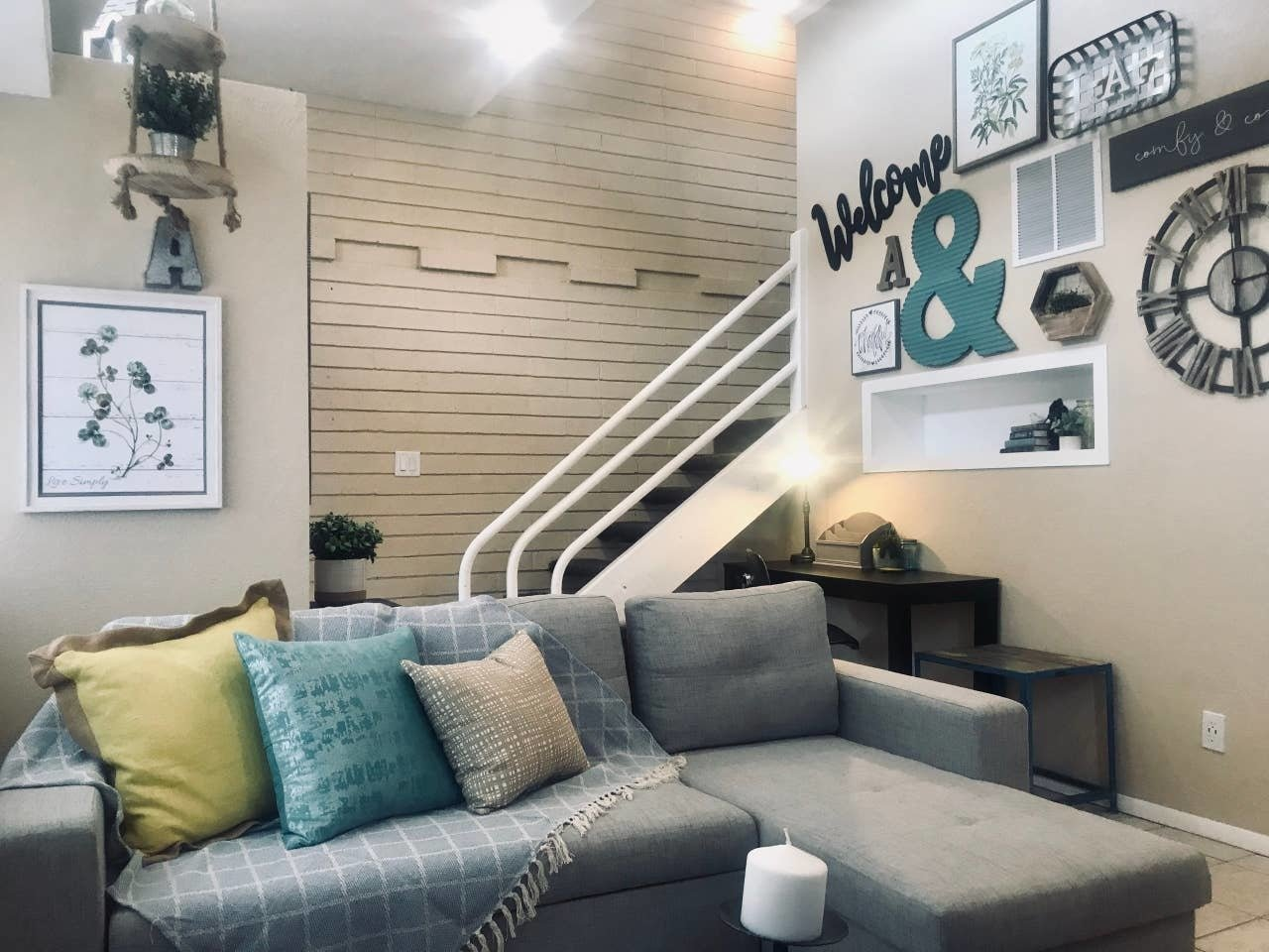 Living Room, Sectional, Ceiling Lighting, Ceramic Tile Floor, and Table Lighting  Nakomis Dwellings