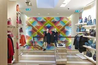 The prismatic hues of Maya Hayuk's mural complement the hot and cool tones of the merchandise lining the walls.