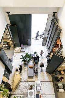 A bird's eye view reveals how the once utilitarian space has been transformed into a gallery setting.