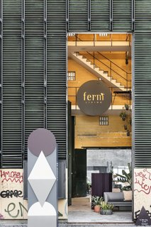 The building's metal exterior and scrawled graffiti stand in contrast to the brand's classic Scandinavian designs.