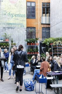 A plant shop occupies a section of the courtyard, where shop visitors can gather over coffee, pastries, ice cream, and more.