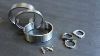Current product offerings include the thin, standard, and wide cuffs; mini bar earrings; and lightweight short slab ring.