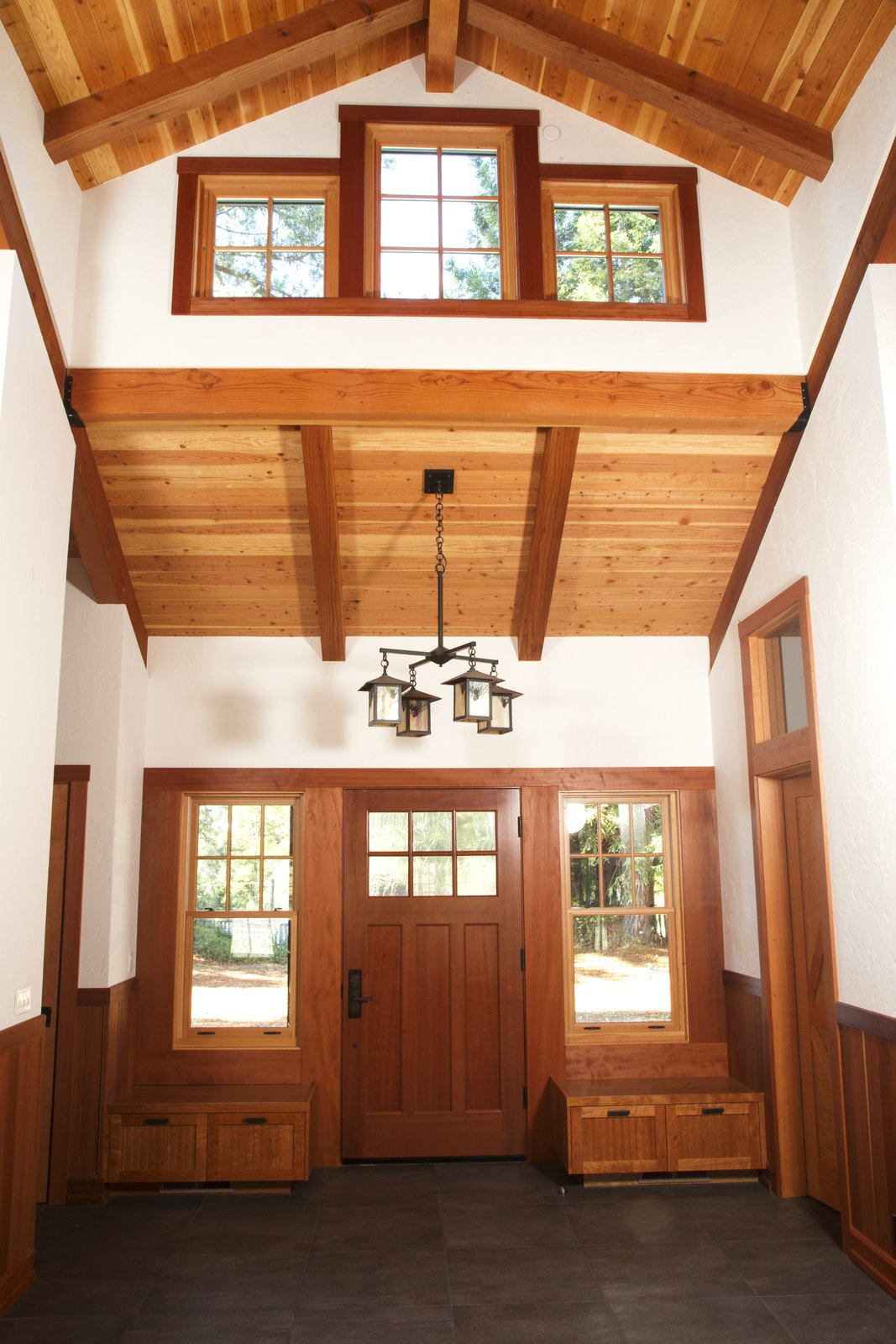 A home in Sonoma County, California uses redwood for the interior beams, trim, and entryway storage to evoke a pastoral warmth.  Photo 6 of 7 in Beauty and Brains: Building Sustainably With Redwood