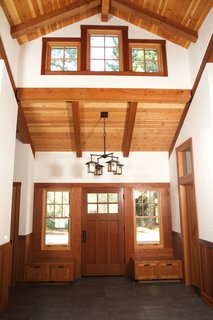 A home in Sonoma County, California uses redwood for the interior beams, trim, and entryway storage to evoke a pastoral warmth.