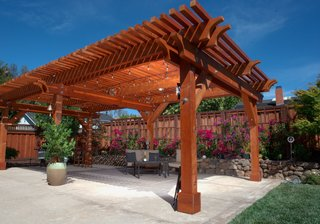 A versatile material, redwood can be left to turn a rustic, silver-tone gray, or finished to take on a glowing tint. A pergola such as this one, which will accompany Humboldt Redwood Company at Dwell on Design, can imbue your backyard space with both stateliness and charm.