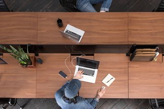 A central channel powers the office while keeping cords and wires out of sight.
