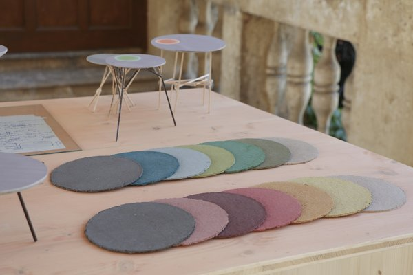 Representing the layered history of Schloss Hollenegg, each slab is made out of pigments, glue, sawdust, and paper.