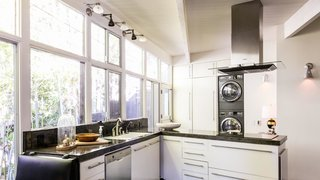 Modern appliances find a home in an airy kitchen.