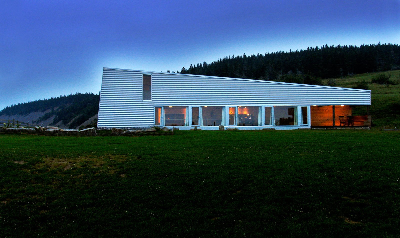 Exterior, Cabin Building Type, Shed RoofLine, House Building Type, and Glass Siding Material Situated on a cliff, the studio blocks the northern wind that blows over the sea.  Photo 3 of 13 in Agrarian Pastime: Book a Village Stay in Nova Scotia