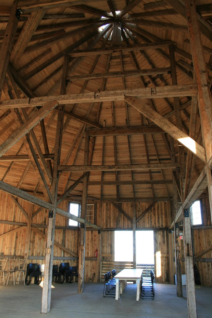 Living Room, Chair, Table, and Light Hardwood Floor At 2,000 square feet, the barn is an ideal setting for weddings, retreats, parties, and performances.  Photo 8 of 13 in Agrarian Pastime: Book a Village Stay in Nova Scotia