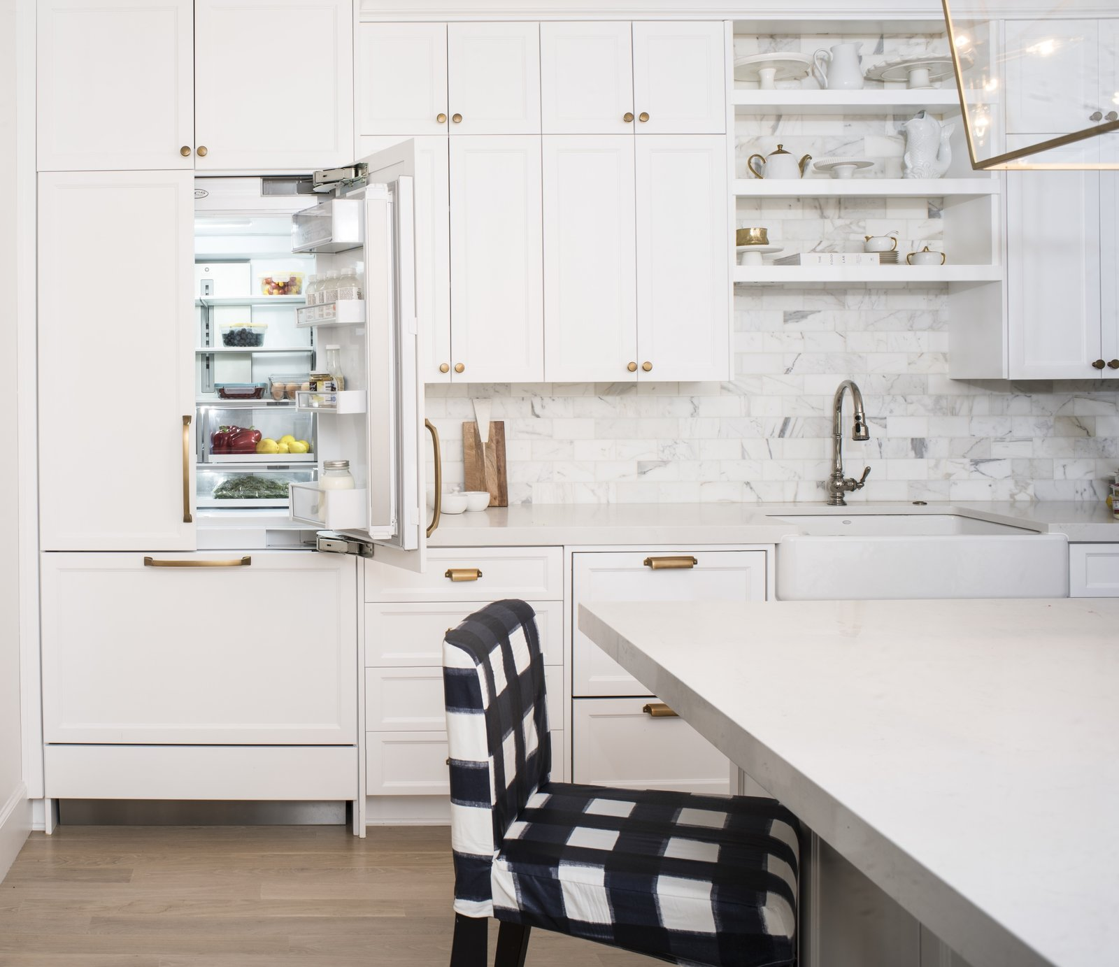 When closed, the integrated fridge becomes flush with the cabinetry. DCS's ActiveSmart Foodcare technology monitors fridge use and adapts the temperature to keep food fresh.  Photo 7 of 8 in An Interior Designer's Streamlined Kitchen