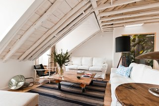 Ultramar is the largest apartment in the building with three bedrooms and two bathrooms. The original wooden beams were left exposed and painted white, and the skylights were restored to allow for natural light.