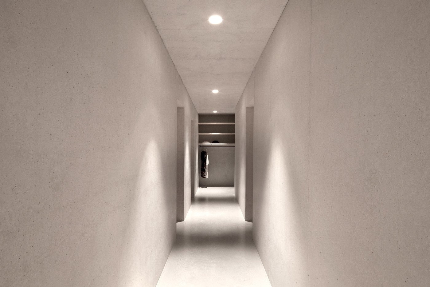 Hallway and Concrete Floor The minimal interior lends a modern feel to the chalet.  Photo 9 of 12 in Find Sanctuary in This Chalet in the Italian Alps