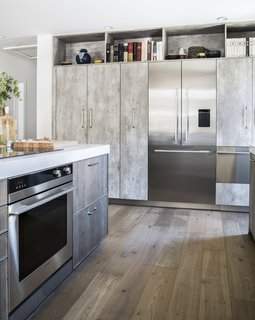 "The Integrated French Door Refrigerator by Fisher & Paykel is seamlessly fitted to the kitchen cabinetry. ActiveSmart Foodcare monitors how the family uses the fridge to maintain a controlled climate and keep food fresh. Beside the fridge, the CoolDrawer provides flexibility with 5 temperature settings ranging from freezer to chill, fridge, pantry, and wine modes. ""I tend to use my CoolDrawer for wine and overflow beverages, but it comes in handy as extra chill space for vegetables or converted to a freezer when we decide to have an ice cream party,"" says Lefebvre."