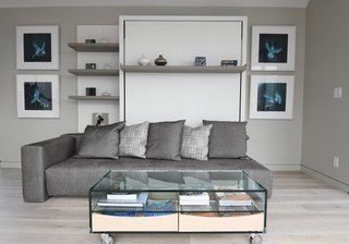 Monogram Modern Home at the Heart of Houston's Arts District - Photo 3 of 7 - Interior designer Shane Cook chose gray and beige as the predominant colors for the home, using blue accents to liven up the space.