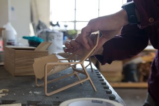 """We're really driven by understanding the costs of various materials and manufacturing processes,"" says Blanks. As the design team has grown, it has become more systematic in identifying needs and rounding out the portfolio. After receiving a design brief, a designer pins up initial sketches and produces scale models for group critique. Above, a Toro Chair takes shape."
