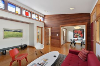 Clerestory windows, outfitted with stained glass in the living room, allow light to bathe nearly every room.