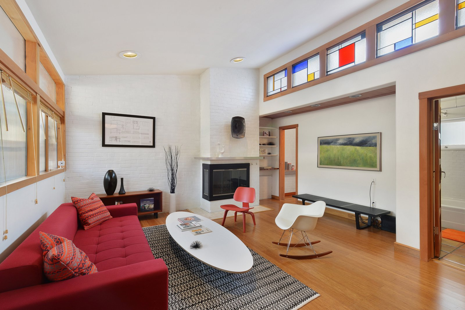 A white brick wall provides visual and material contrast to warm wood elements throughout the home.  Photo 2 of 12 in Artists Need Apply: This Midcentury Home Comes With an All-Purpose Workshop for $949K