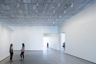 The exhibition spaces have polished concrete floors and custom aluminum mesh ceilings that are fitted with occupant-controlled LED lights. The museum is on course to be LEED-certified.
