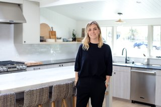 """The Big Reveal: An Interior Designer Unveils Her """"No Ordinary Kitchen"""" Makeover - Photo 1 of 9 - As a child, Lewis would accompany her father on construction site visits, an experience that kindled her interest in interior design and home renovation. Following a stint in fashion school, a few semesters in the UCLA interior design program, and a gig as an assistant at an interior design firm, Lewis launched her own business. The rest, as they say, is history: Amber Interiors is now a design-build firm with clients all across the country. Lewis's distinctive aesthetic favors clean white walls, colorful textiles, brushed metals, and nature. With a robust online following, she has also launched a furniture and home goods line, an e-commerce business, and a brick-and-mortar store."""