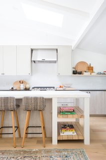 """Lewis relished the decorating process, arraying the floating shelves with ceramics, art, and plants. Now that her kitchen renovation is complete, she jumps at the chance to host. One caption on her Instagram feed jokes, """"We are basically just finding any reason at all to invite our friends and family over to cook and entertain. 'Oh you made it to work on time today?!...Great, come on over, we will cook something for you."""""""