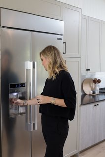 """The Big Reveal: An Interior Designer Unveils Her """"No Ordinary Kitchen"""" Makeover - Photo 4 of 9 - Lewis's guests marveled at the 42 inch Built-In Side-By-Side Refrigerator, whose impressive capacity is due to a SmartSpace™ system that embeds the ice dispenser in the freezer door. ''The refrigerator is spacious, and has a really great function that maintains the temperature even when I have the fridge open for a longer period of time when unpacking my groceries,'' says Lewis. The flexible system of cantilevered shelves can be easily adjusted at the touch of a button. An LED touch control panel hints at the appliance's technological bent: the Signature Kitchen Suite App allows Lewis to monitor energy use, delay defrosting, and check on the fridge's performance with Smart Diagnosis."""