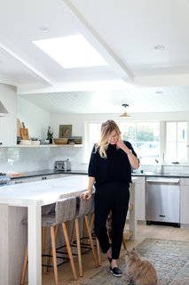 """""""Our kitchen is the center of our home—I love being able to talk about the day's events while my husband cooks and Gwynnie does her homework. It's the perfect place to unwind and relax,"""" says Lewis."""