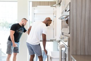 Monogram Modern Home Shows Some Southern Hospitality - Photo 2 of 8 - Guests get a feel for the fully integrated refrigerator, which offers customizable climate control in three zones and a convertible lower drawer.