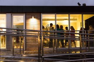 During a rainy evening, the Monogram Modern Home provided a warm refuge.