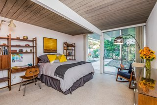 The master bedroom enjoys a spacious walk-in closet and opens to the backyard.