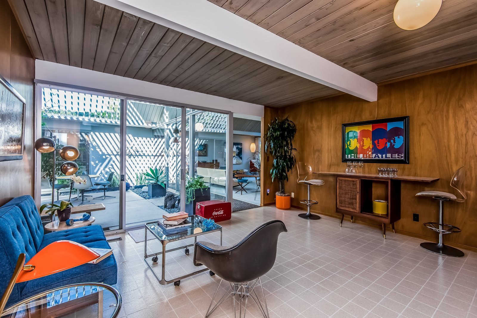 Like so many rooms, the multipurpose room has free access to the atrium, maintaining the indoor/outdoor lifestyle that Eichler championed.  Photo 11 of 13 in With Only One Previous Set of Owners, a Pristine Eichler Home Asks $799K