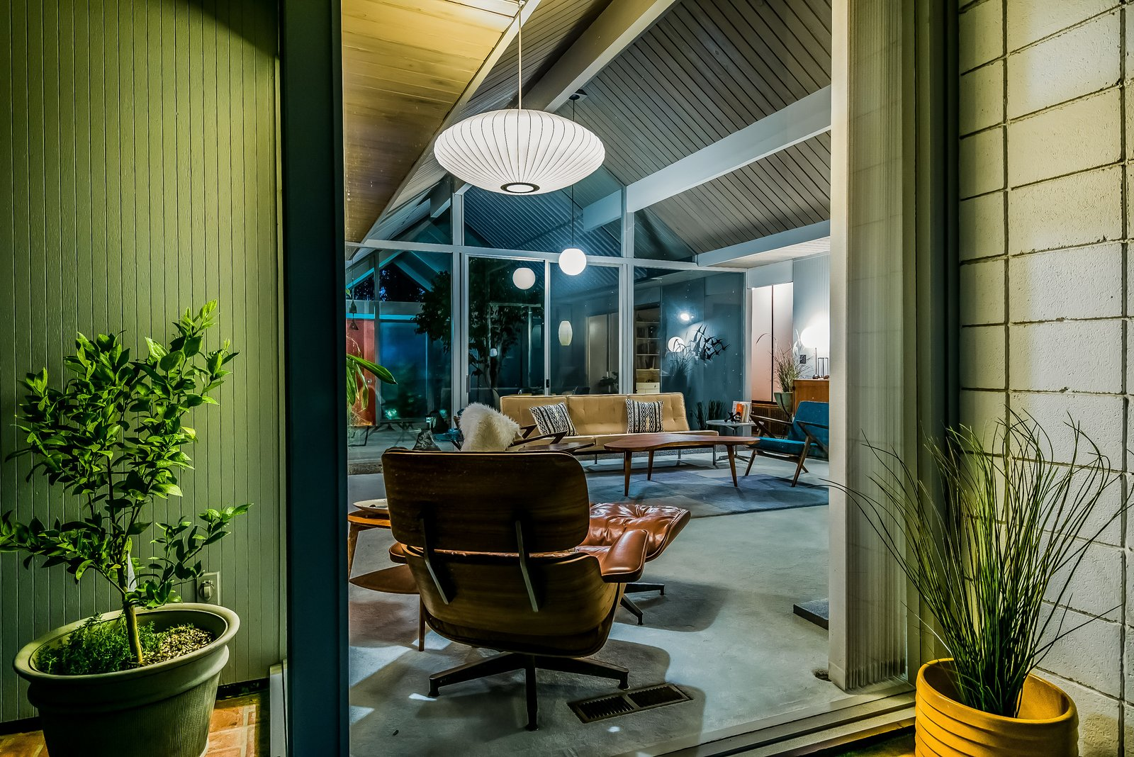 An original Eames Chair Lounge and Ottoman complete the midcentury setting.  Photo 6 of 13 in With Only One Previous Set of Owners, a Pristine Eichler Home Asks $799K