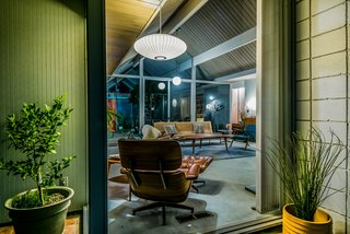 "An original Eames Chair Lounge and Ottoman complete the midcentury setting. Shares Guinto, ""Larry, before he passed, was such a great resource for the new homeowners in the Balboa Highlands neighborhood. When I sold another Eichler home on Lisette [Street], I was door-knocking the neighborhood to keep them in the know, and I remember Larry eagerly inviting me in to show me around. Even from his wheelchair and impaired mobility, you could see the enthusiasm he had for his home—which is the beauty with these one-story pieces of art. True pride of ownership."""