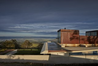 The concrete roof of Invisible House cantilevers almost four meters west and four meters east, shielding the house and creating a dam that contributes to its disappearing effect.