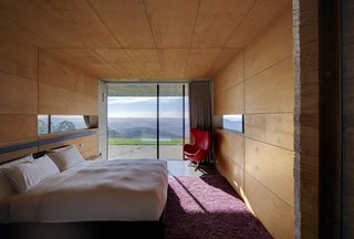 The four bedrooms are encased in warm plywood, offering intimacy while still providing access to grand vistas.