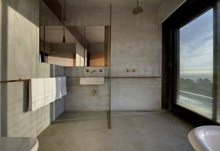 One of the bathrooms is lofted on the second level alongside two other bedrooms.