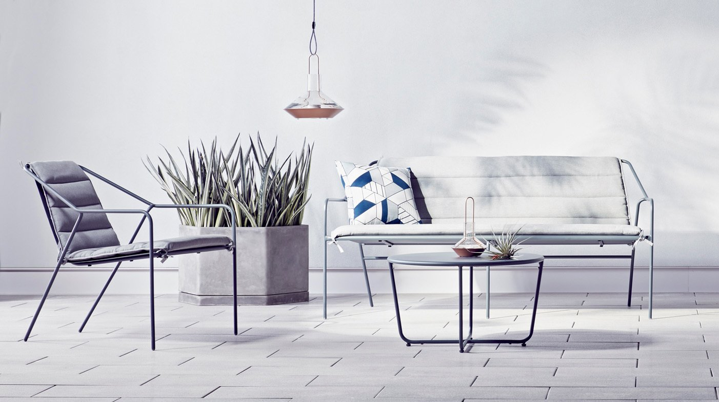 Copper lanterns ($34.99 for the large) add metallic accents to an outdoor setting. The Outdoor Sofa in gray, $399.99, gets an extra layer of comfort with the Sofa Cushion in gray, $109.99.  Photo 10 of 10 in The Dwell x Target Lookbook Reveals a Sleek New Collection for the Modern Home