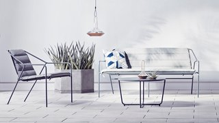Copper lanterns ($34.99 for the large) add metallic accents to an outdoor setting. The Outdoor Sofa in gray, $399.99, gets an extra layer of comfort with the Sofa Cushion in gray, $109.99.