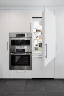 "While the cooking appliances remain in the open, the Bosch refrigerator, freezer, and dishwasher are integrated into the cabinetry. ""They're hidden to create a furniture aesthetic,"" says Brunn, which was a priority to allow the kitchen to flow into the rest of the home."