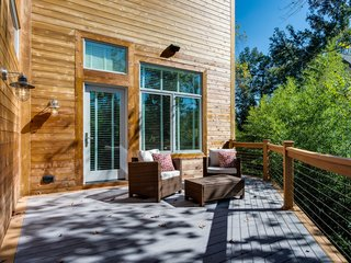 Approximately 516 square feet, the back deck is comprised of two-toned cedar and gray composite wood. Four all-weather speakers provide entertainment, and the reinforced left side allows for hot tub installation.