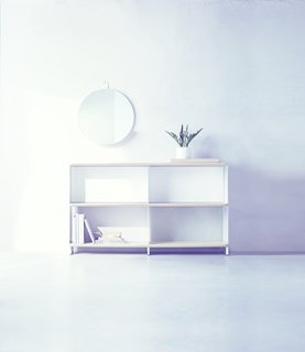 The Wait Is Over: Modern by Dwell Magazine Arrives at Target - Photo 4 of 9 - A Round Metal Shelf Mirror ($69.99) provides a small catch-all storage solution above a Bookshelf ($249.99) which combines open and closed backing.