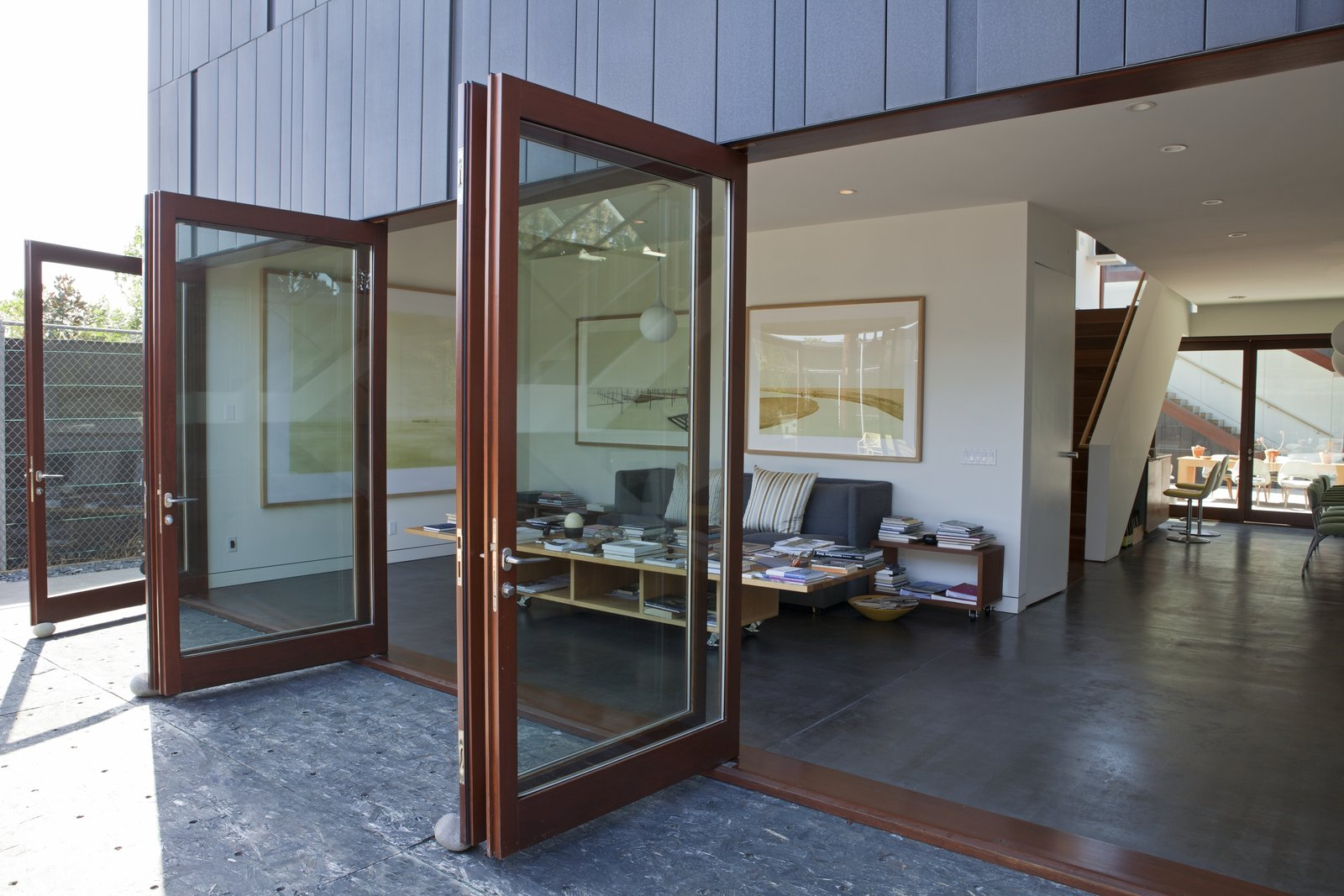 A courtyard sandwiched between the main house and the studio structure offers an outdoor platform for entertaining.  Photo 3 of 9 in Live Outside the Box in This Artist's Haven For $3.5M