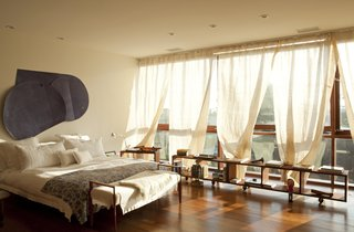 The master suite on the third floor enjoys a view of the surrounding city.