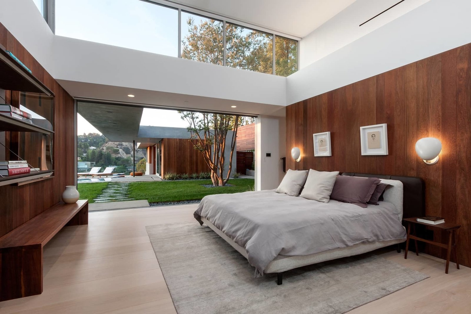 The master bedroom also has seamless outdoor access. The covered breezeway leads to the guest house, comprised of its own living space, kitchen, and bedroom, currently being used as an office.  Photo 6 of 10 in A Celeb-Worthy Home in Beverly Hills Asks $6.75M