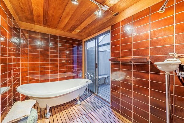 The freestanding tub in the master bath leads to a private, raised deck.