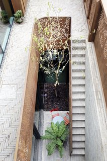 A sunken courtyard acts like a light well illuminating the basement, which is currently set up as a playroom, though it can be renovated to become additional bedrooms, an office, a self-contained studio, or even a lap pool.