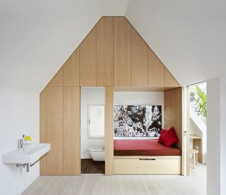 An en-suite bathroom, walk-in closet, and window seat complete the bedroom. A bridge leads to a guest room, a family bathroom, and two linked children's bedrooms.
