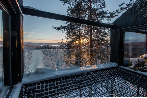 A double-layered net stretches between two bedrooms, providing an open terrace and a place to sleep under the night sky.  Photo 5 of 8 in Go Stargazing in Snøhetta's Towering Addition to Sweden's Treehotel