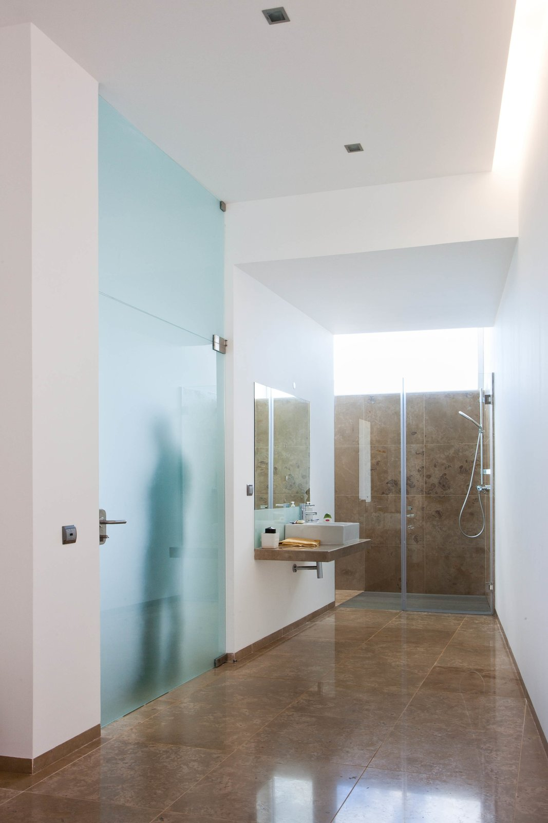 The en-suite bathroom has a large bathtub, shower, and pre-installation for a steam or sauna room.  Photo 5 of 9 in Make This Seaside Villa in Southern Portugal Your Own Private Resort For $2M