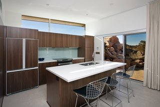 Offered at $674K, This Hybrid Prefab Is in Tune With the Californian Desert - Photo 4 of 7 - The kitchen boasts cabinets from a high-end Canadian vendor. Large cork tiles run throughout the home.